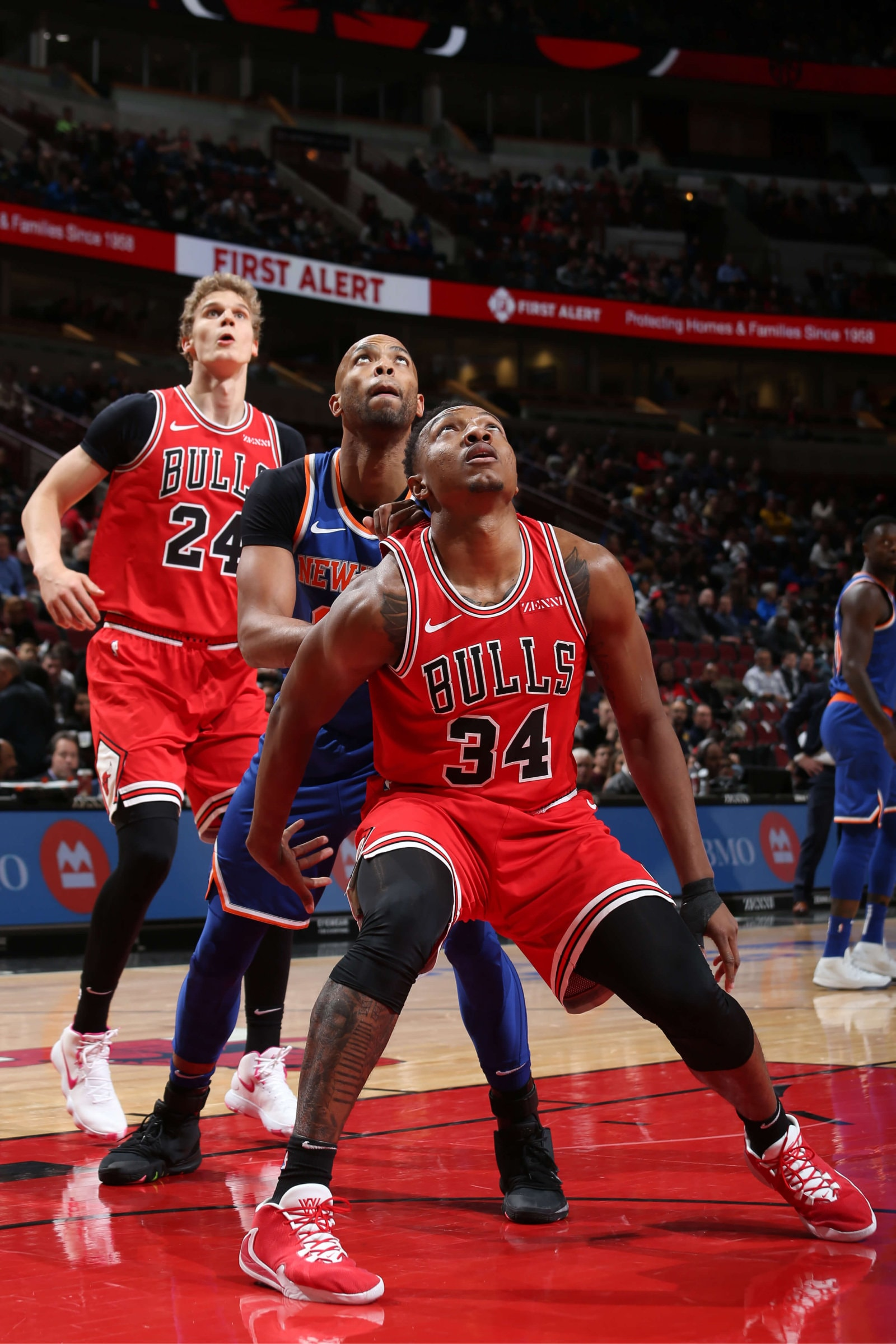Taj Gibson #67 of the New York Knicks and Wendell Carter Jr. #34 of the Chicago Bulls fights for position during the game against the New York Knicks on November 12, 2019 at the United Center in Chicago, Illinois.