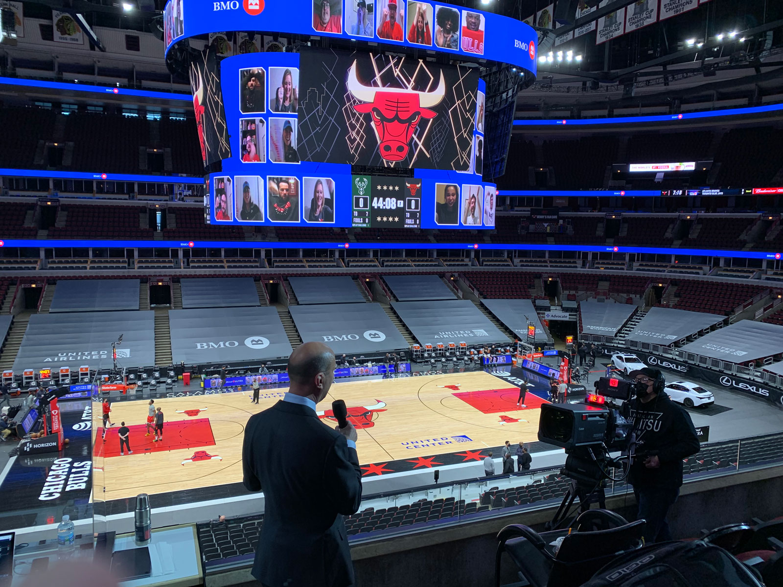 Chuck announcing with the empty united center as a backdrop
