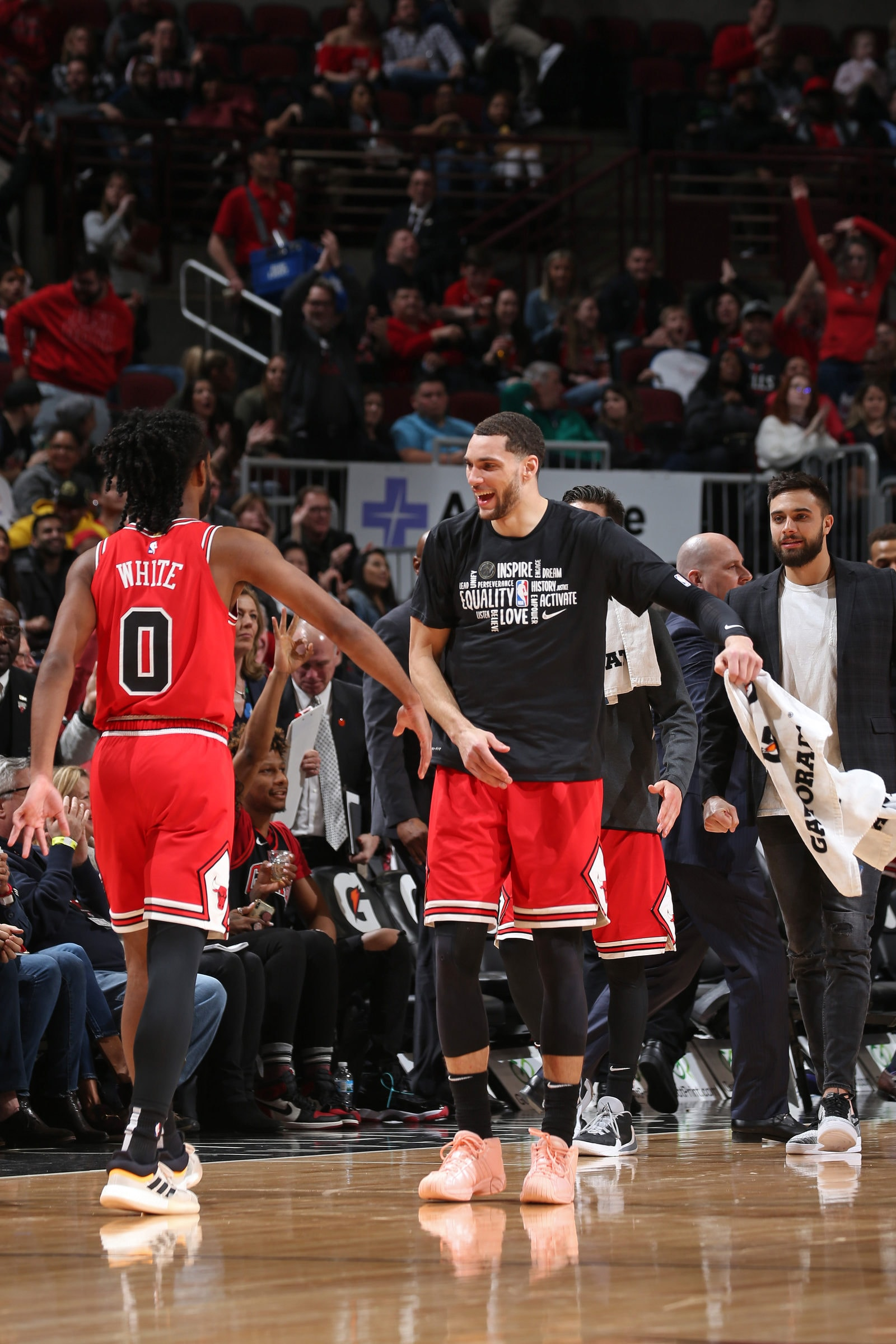 Coby White #0, and Zach LaVine #8 of the Chicago Bulls react to a play during the game against the Washington Wizards on February 23, 2020 at the United Center in Chicago, Illinois.