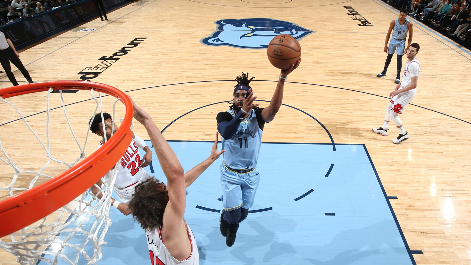 Mike Conley #11 of the Memphis Grizzlies drives to the basket
