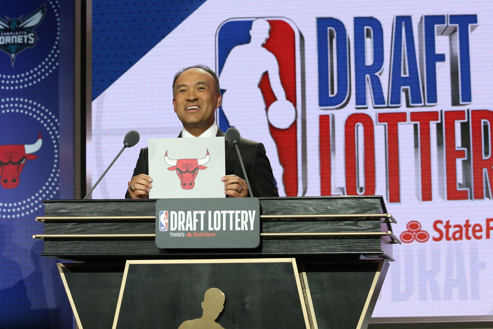 Deputy Commissioner of the NBA, Mark Tatum, holds up the card for the Chicago Bulls after they get the 7th overall pick in the NBA Draft during the 2019 NBA Draft Lottery on May 14, 2019 at the Chicago Hilton in Chicago, Illinois.