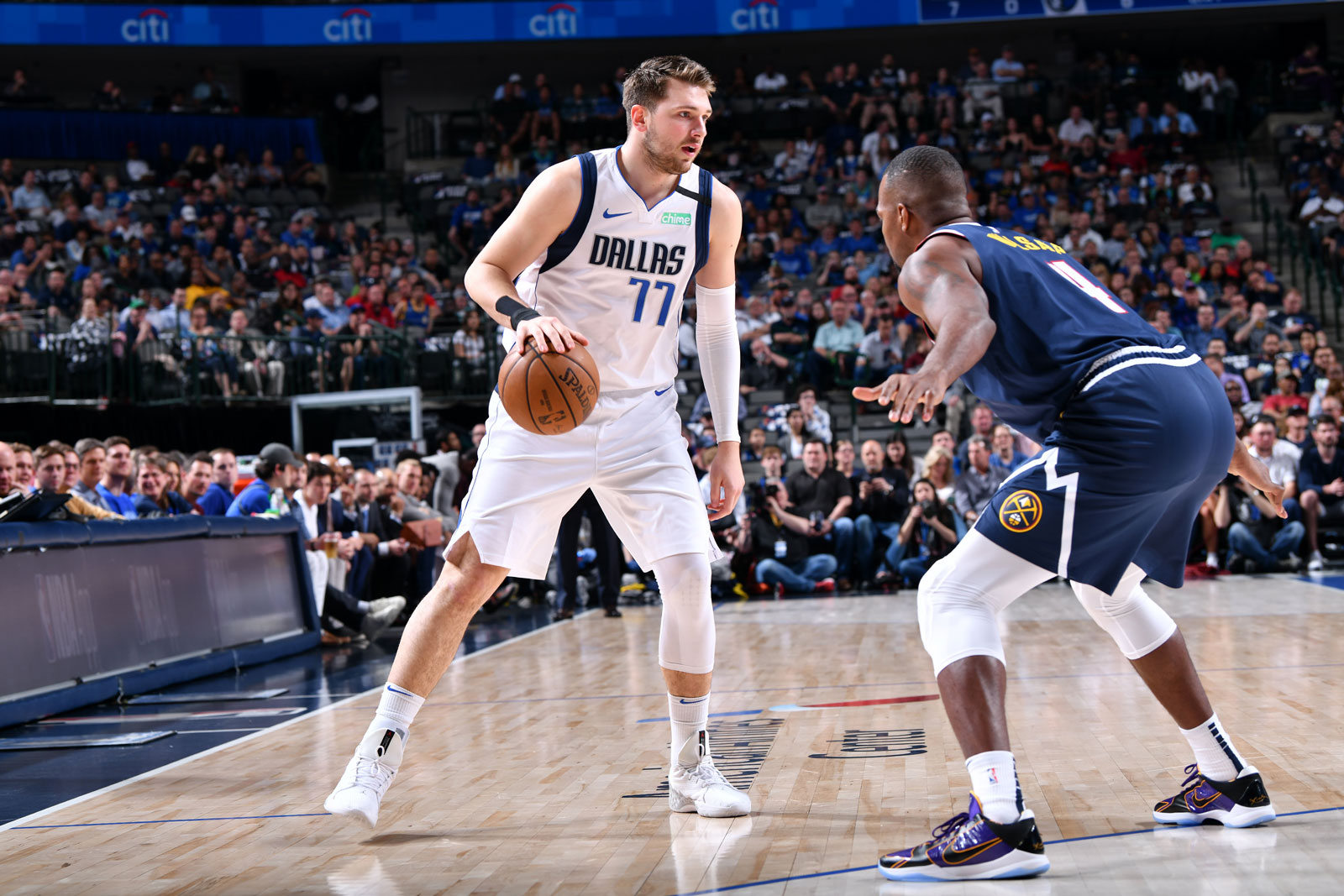 Luka Doncic #77 of the Dallas Mavericks handles the ball against the Denver Nuggets on March 11, 2020 at the American Airlines Center in Dallas, Texas