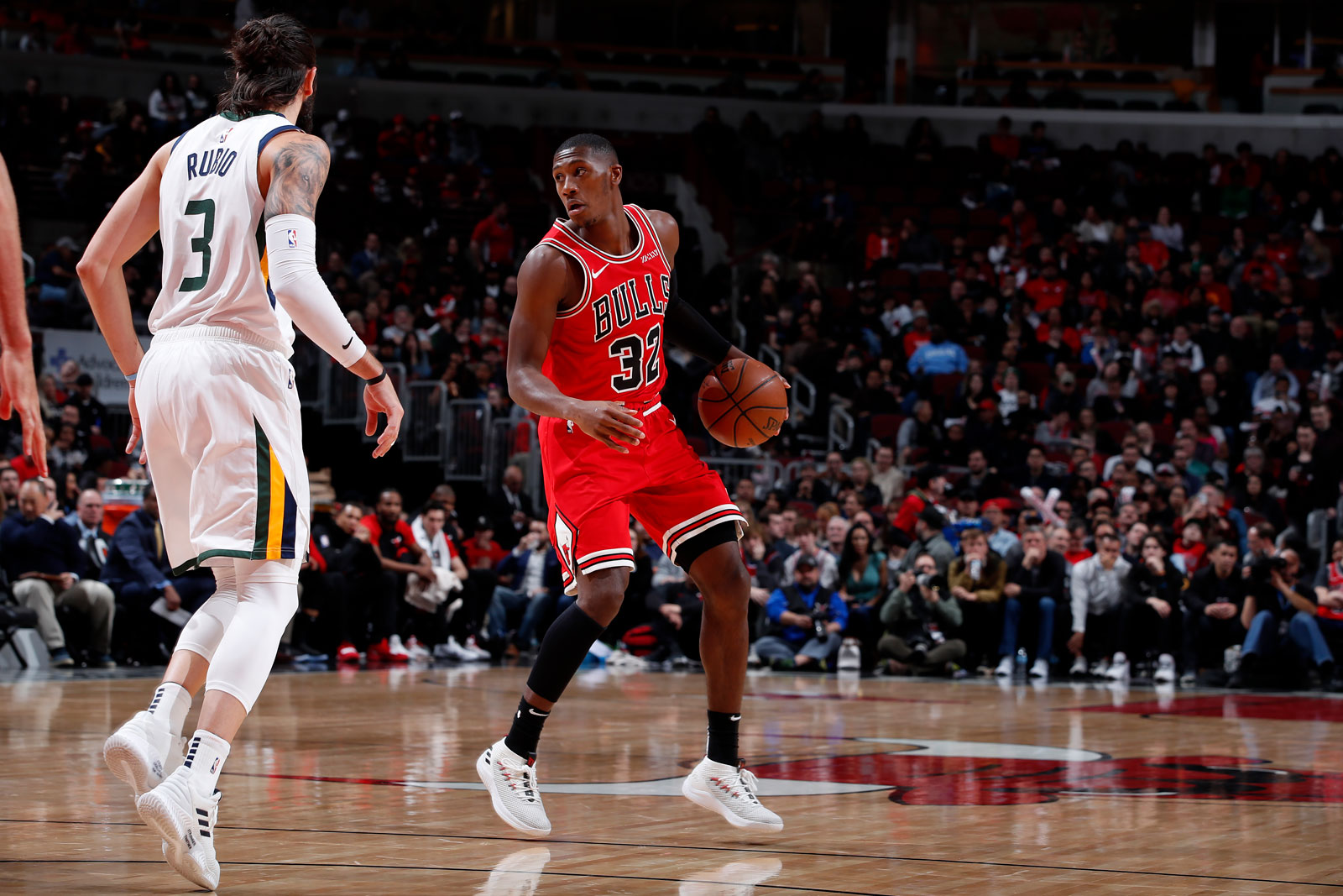 Kris Dunn #32 of the Chicago Bulls handles the ball against the Utah Jazz on March 23, 2019 at United Center in Chicago, Illinois.