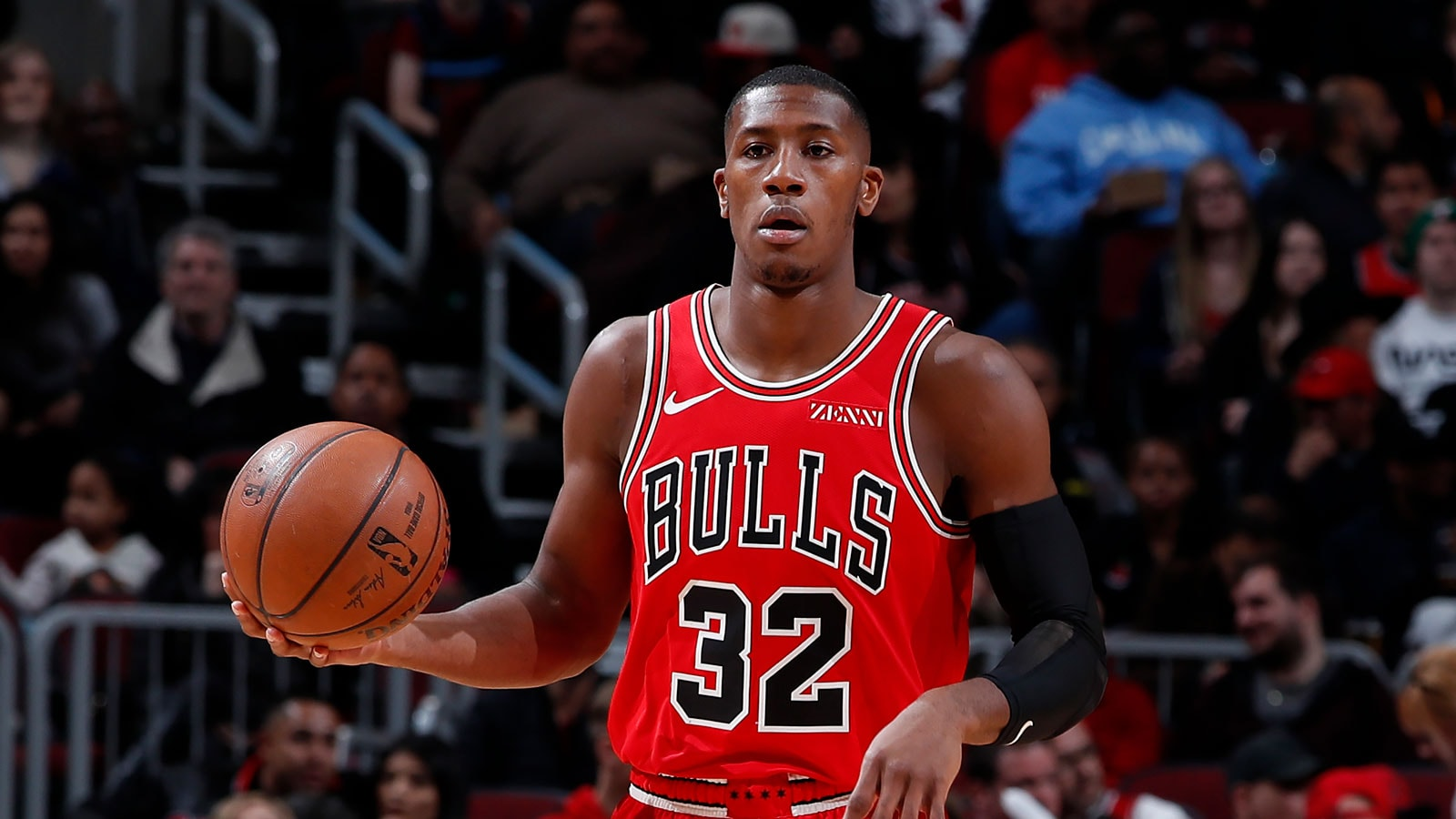 Kris Dunn #32 of the Chicago Bulls handles the ball against the Charlotte Hornets on March 23, 2019 at United Center in Chicago, Illinois.