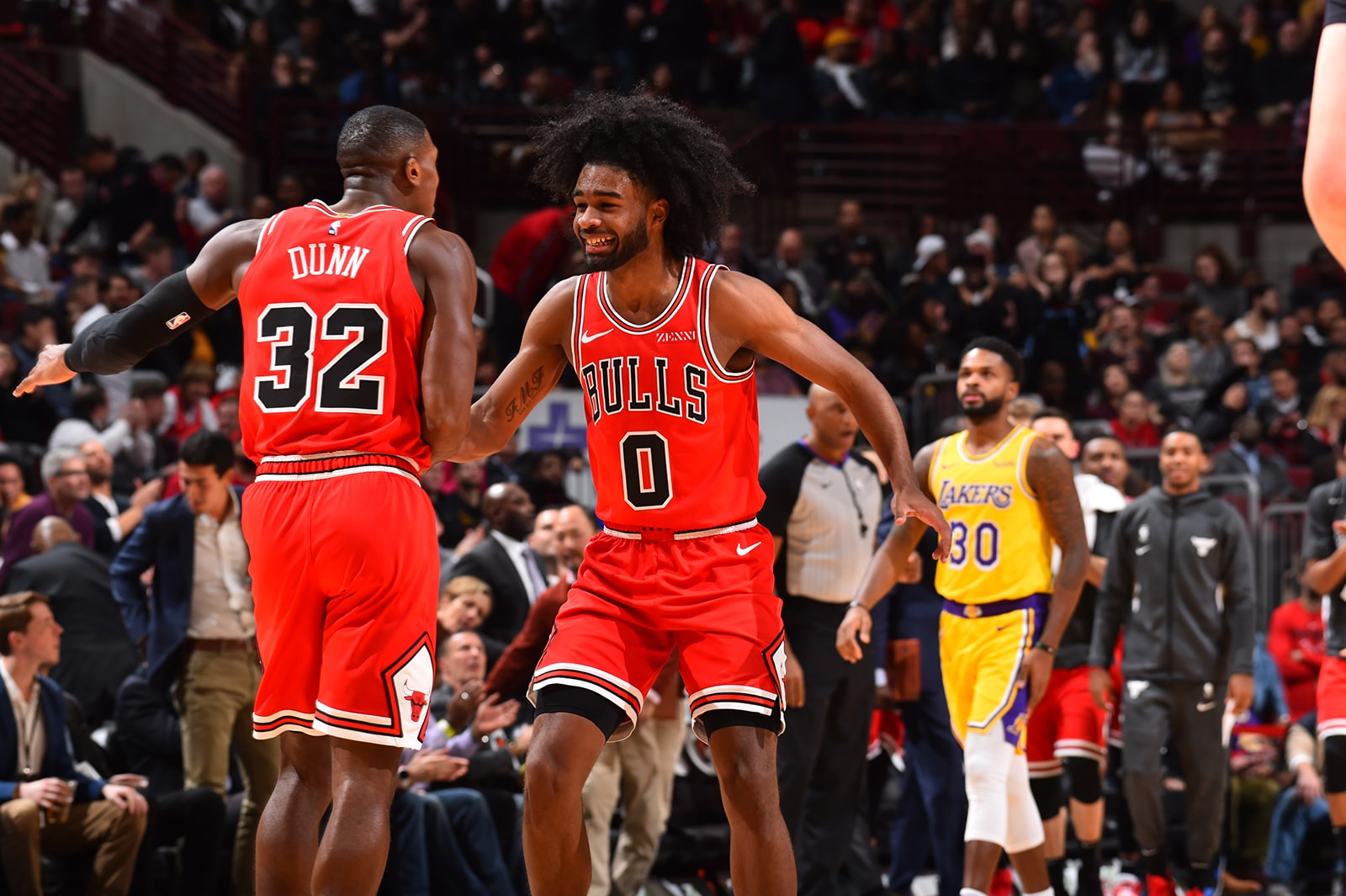 Kris Dunn & Coby White celebrate on the court