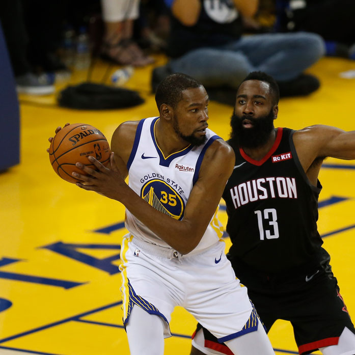 Kevin Durant #35 of the Golden State Warriors is guarded by James Harden #13 of the Houston Rockets during Game Five of the Western Conference Semifinals of the 2019 NBA Playoffs at ORACLE Arena on May 08, 2019 in Oakland, California.