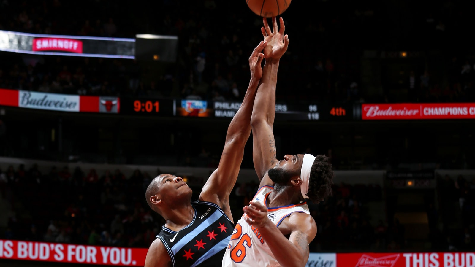 A jump-ball between Cristiano Felicio #6 of the Chicago Bulls and Mitchell Robinson #26 of the New York Knicks on April 9, 2019 at the United Center in Chicago, Illinois.
