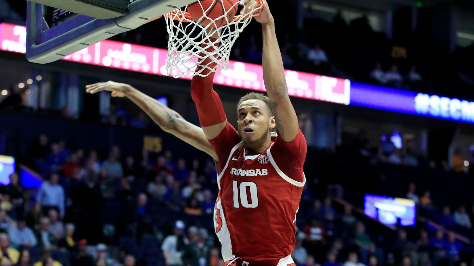Daniel Gafford #10 of the Arkansas Razorbacks dunks the ball against the Florida Gators during the second round of the SEC Basketball Tournament at Bridgestone Arena on March 14, 2019 in Nashville, Tennessee.