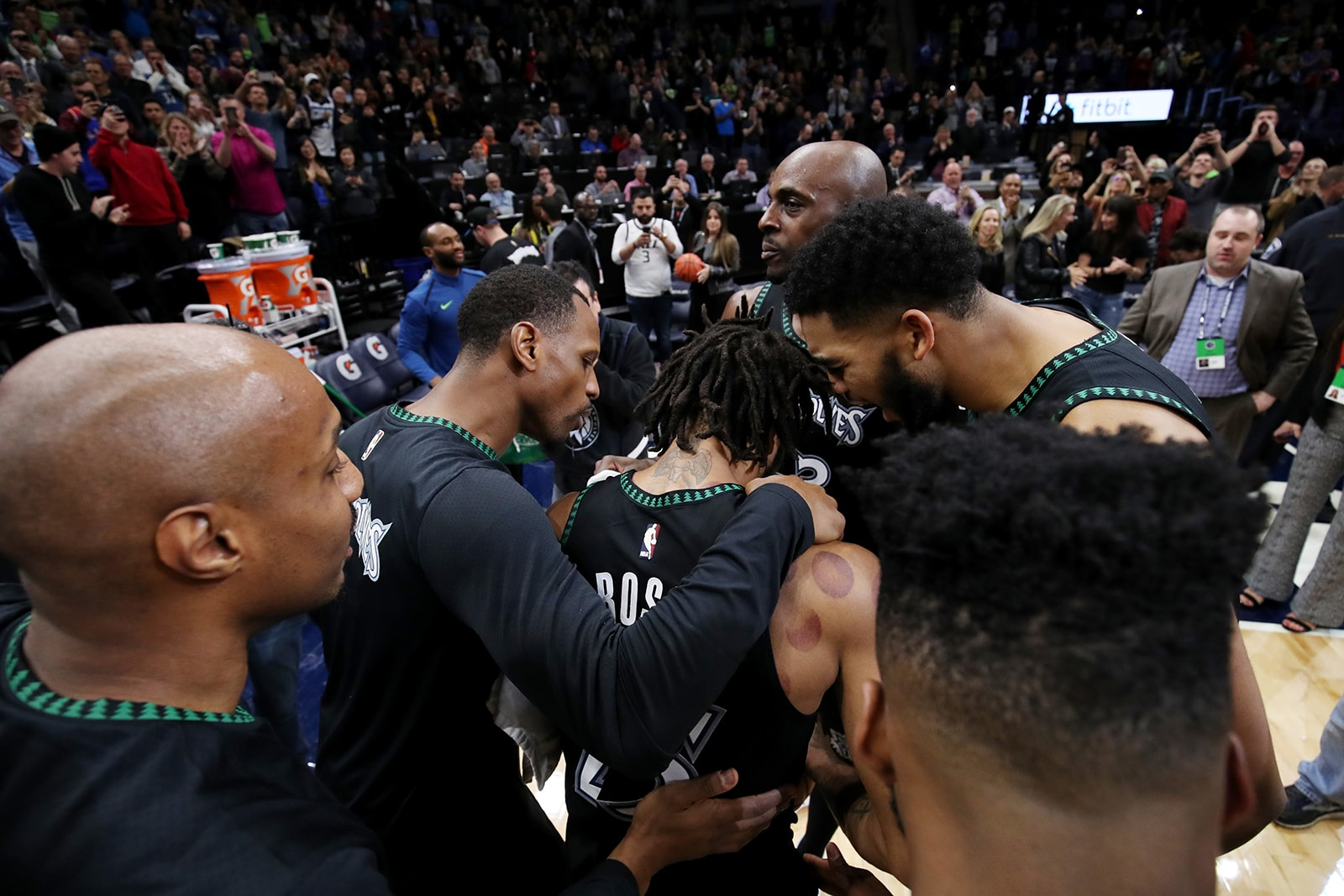 Rose's teammates embrace him after his 50 point game for the Timberwolves last season