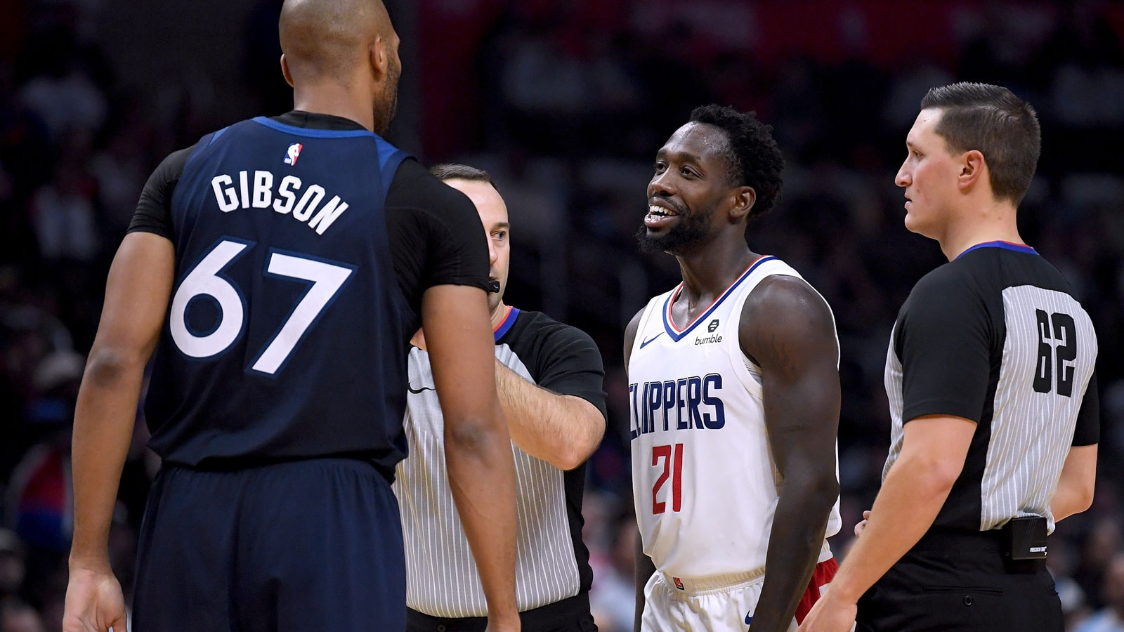 Referees break get between Taj Gibson #67 of the Minnesota Timberwolves and Patrick Beverley #21 of the LA Clippers after a foul during a 120-109 Clipper win at Staples Center on November 5, 2018 in Los Angeles, California.