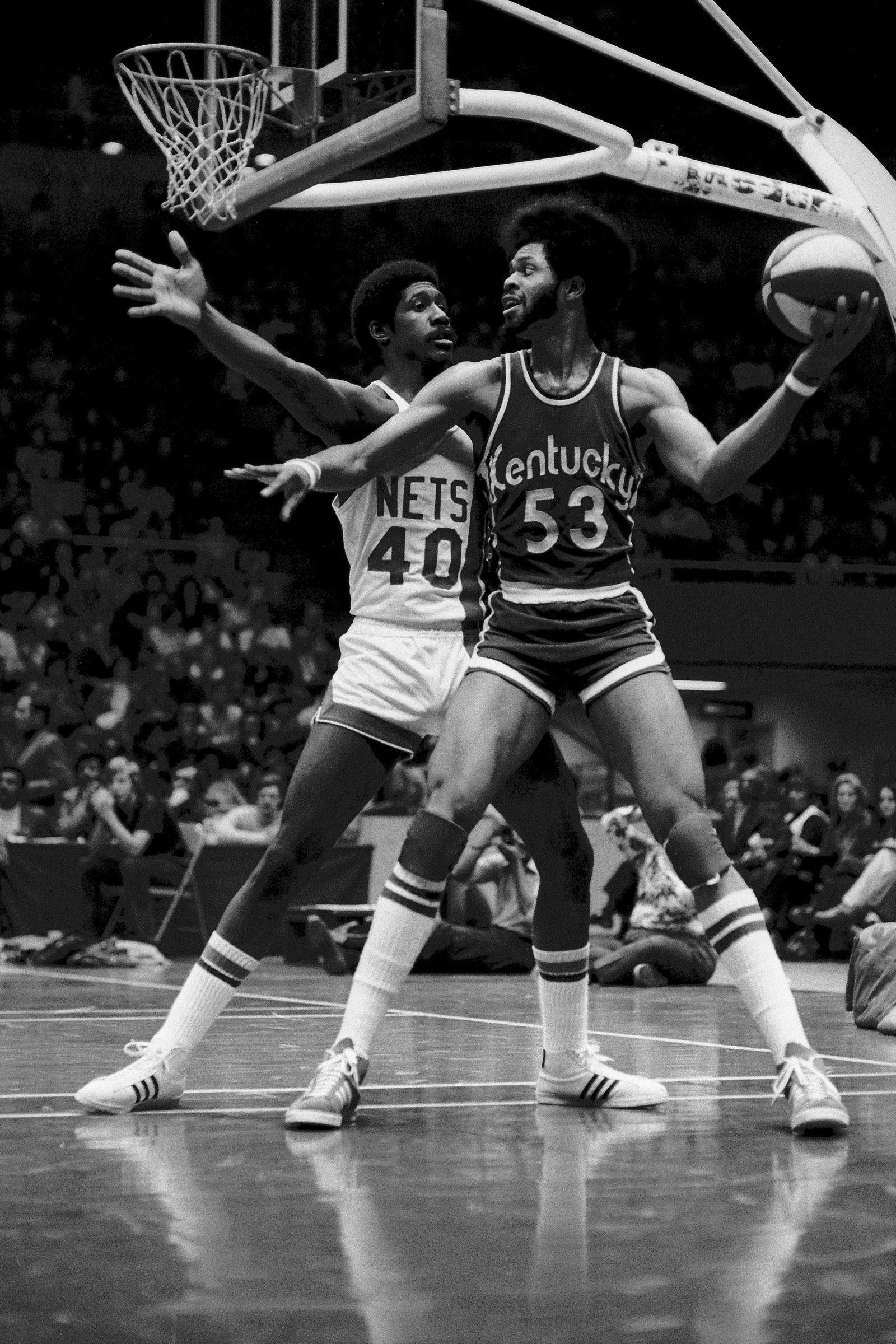 Artis Gilmore #53 of the Kentucky Colonels looks to pass against the New Jersey Nets during a game played in 1975 at the Brendan Byrne Arena in East Rutherford, New Jersey.