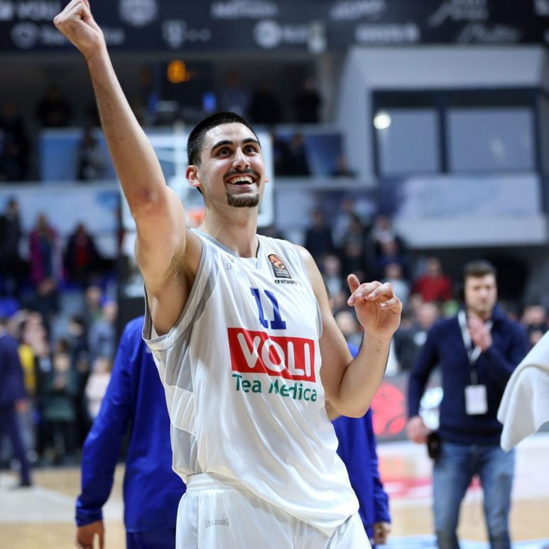 Goga Bitadze reacts to a play