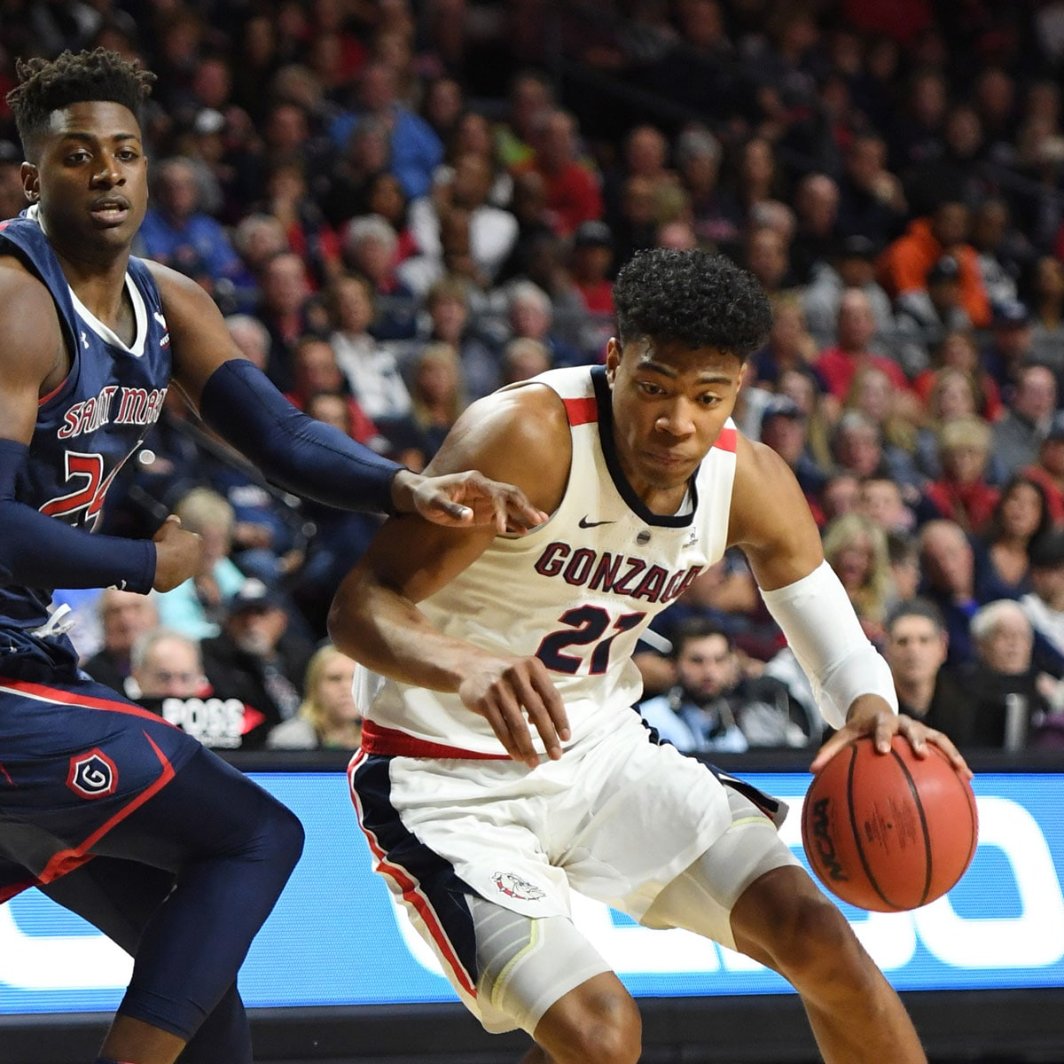 Rui Hachimura #21 of the Gonzaga Bulldogs drives against Malik Fitts #24 of the Saint Mary's Gaels during the championship game of the West Coast Conference basketball tournament at the Orleans Arena on March 12, 2019 in Las Vegas, Nevada. The Gaels defeated the Bulldogs 60-47.