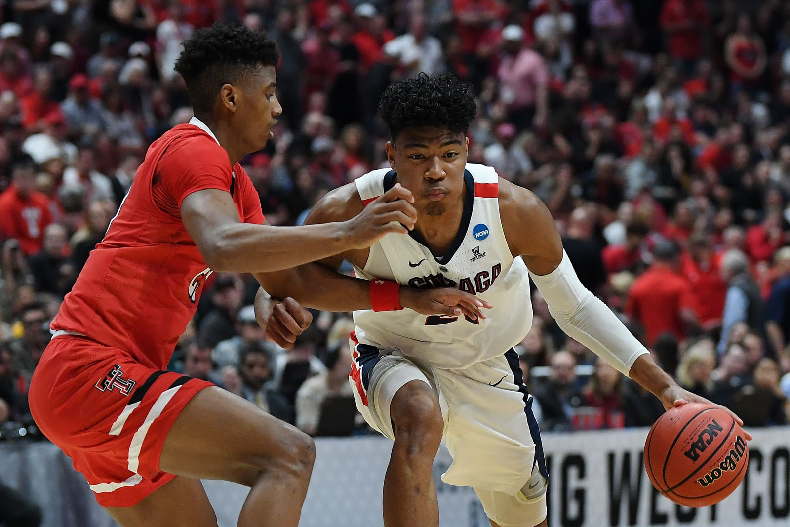 Rui Hachimura #21 of the Gonzaga Bulldogs drives against Jarrett Culver #23 of the Texas Tech Red Raiders during the first half of the 2019 NCAA Men's Basketball Tournament West Regional at Honda Center on March 30, 2019 in Anaheim, California.