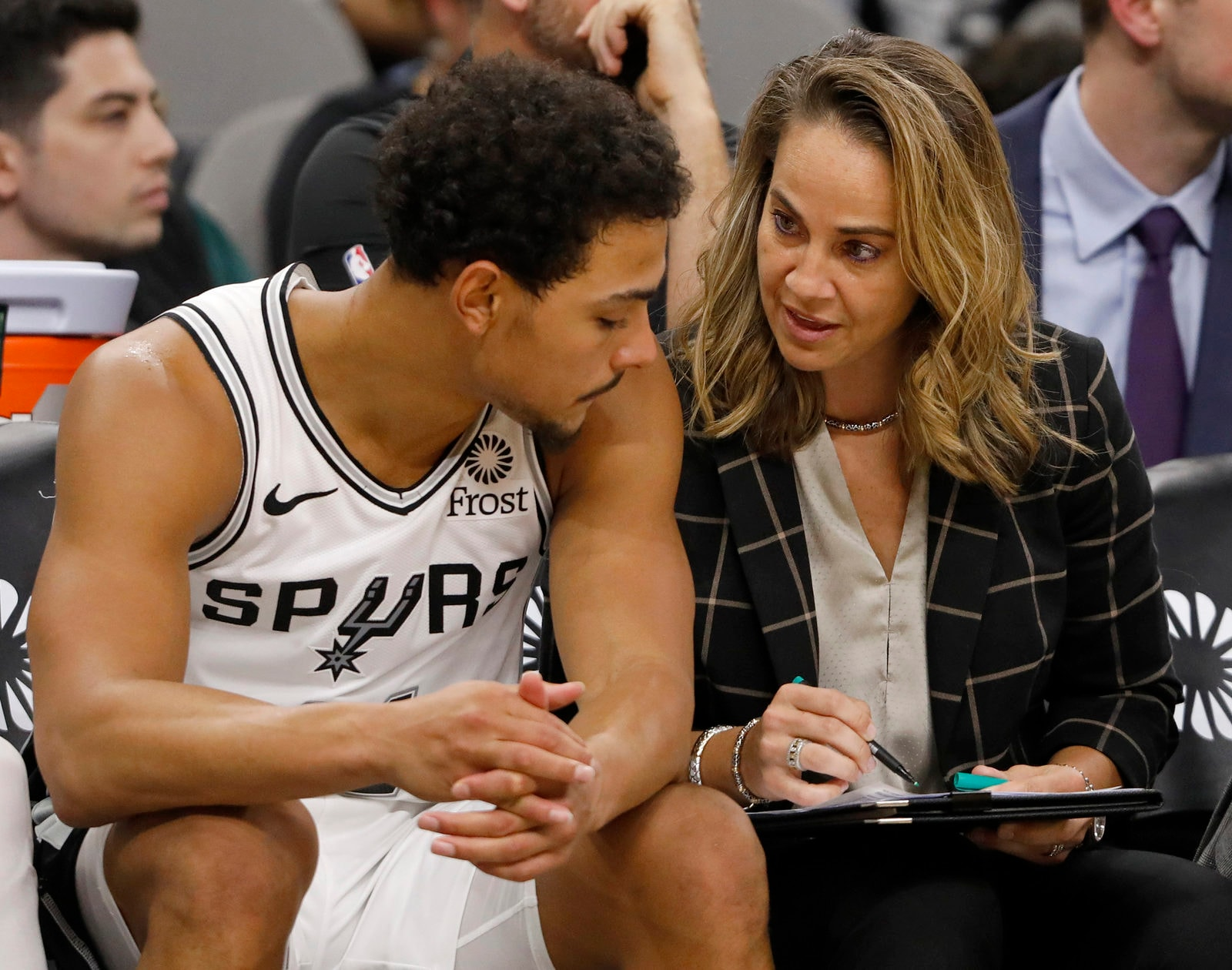 Bryn Forbes #11 of the San Antonio Spurs talks with San Antonio Spurs assistant coach Becky Hammon during an NBA game against the Indiana Pacers on October 24, 2018 at the AT&T Center in San Antonio, Texas.