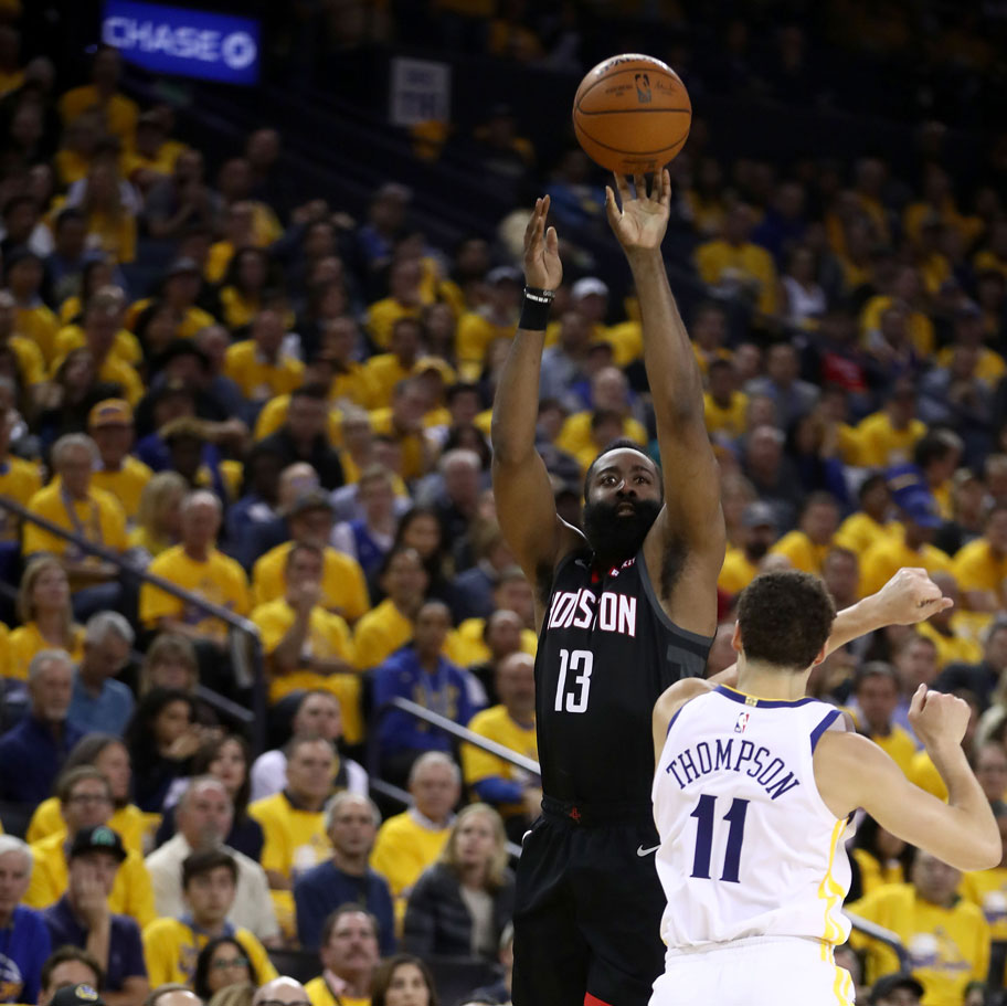 James Harden #13 of the Houston Rockets shoots over Klay Thompson #11 of the Golden State Warriors during Game Five of the Western Conference Semifinals of the 2019 NBA Playoffs at ORACLE Arena on May 08, 2019 in Oakland, California.
