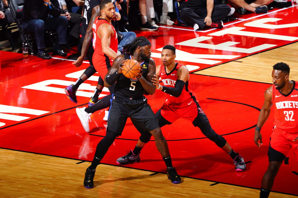 Montrezl Harrell #5 of the LA Clippers posts up on Russell Westbrook #0 of the Houston Rockets on March 5, 2020 at the Toyota Center in Houston, Texas.