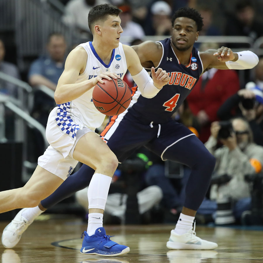 Tyler Herro #14 of the Kentucky Wildcats drives with the ball against Malik Dunbar #4 of the Auburn Tigers during the 2019 NCAA Basketball Tournament Midwest Regional at Sprint Center on March 31, 2019 in Kansas City, Missouri.