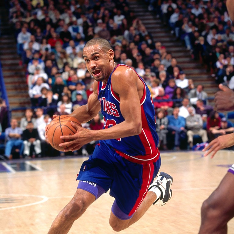 Grant Hill #33 of the Detroit Pistons drives against the Sacramento Kings during a game played on February 26, 1996 at Arco Arena in Sacramento, California.