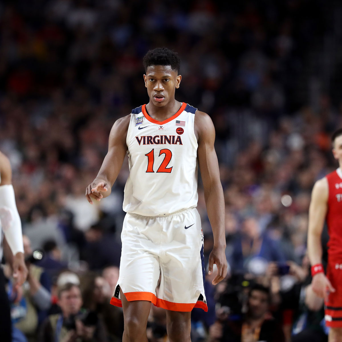 De'Andre Hunter #12 of the Virginia Cavaliers reacts against the Texas Tech Red Raiders in the first half during the 2019 NCAA men's Final Four National Championship game at U.S. Bank Stadium on April 08, 2019 in Minneapolis, Minnesota.
