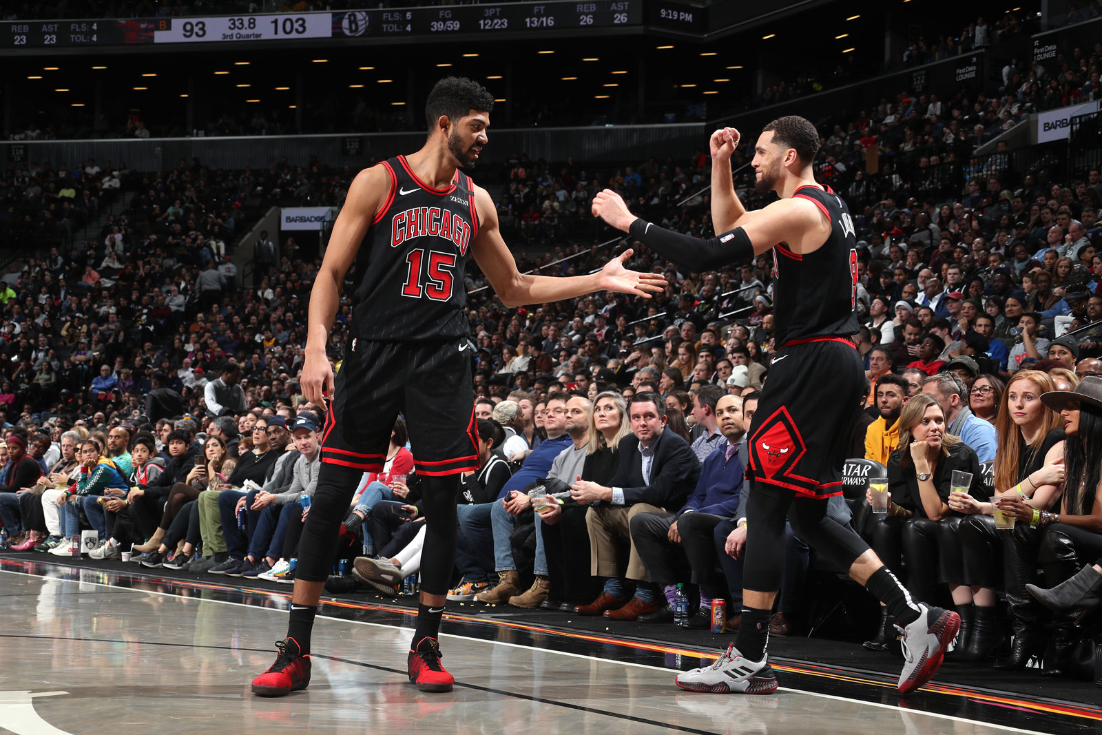 Chandler Hutchison #15 of the Chicago Bulls high-fives Zach LaVine #8 of the Chicago Bulls against the Brooklyn Nets on January 31, 2020 at Barclays Center in Brooklyn, New York.