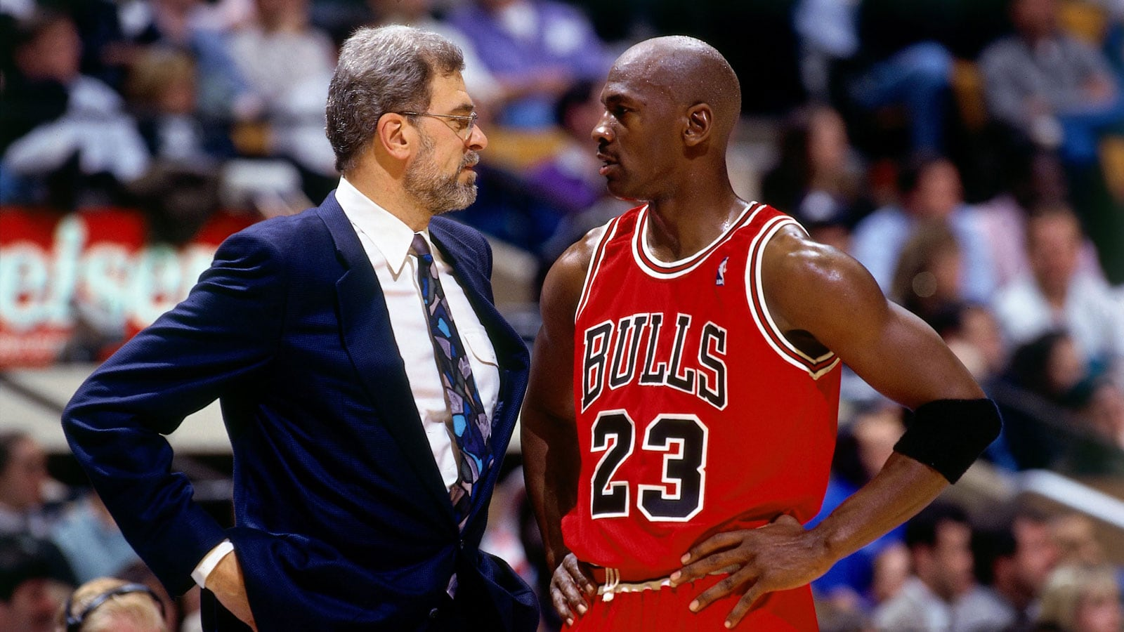 Michael Jordan #23 of the Chicago Bulls discusses strategy with head coach Phil Jackson in Game Six of the 1996 NBA Finals against the Seattle SuperSonics at the United Center on June 16, 1996 in Chicago Iillinois.