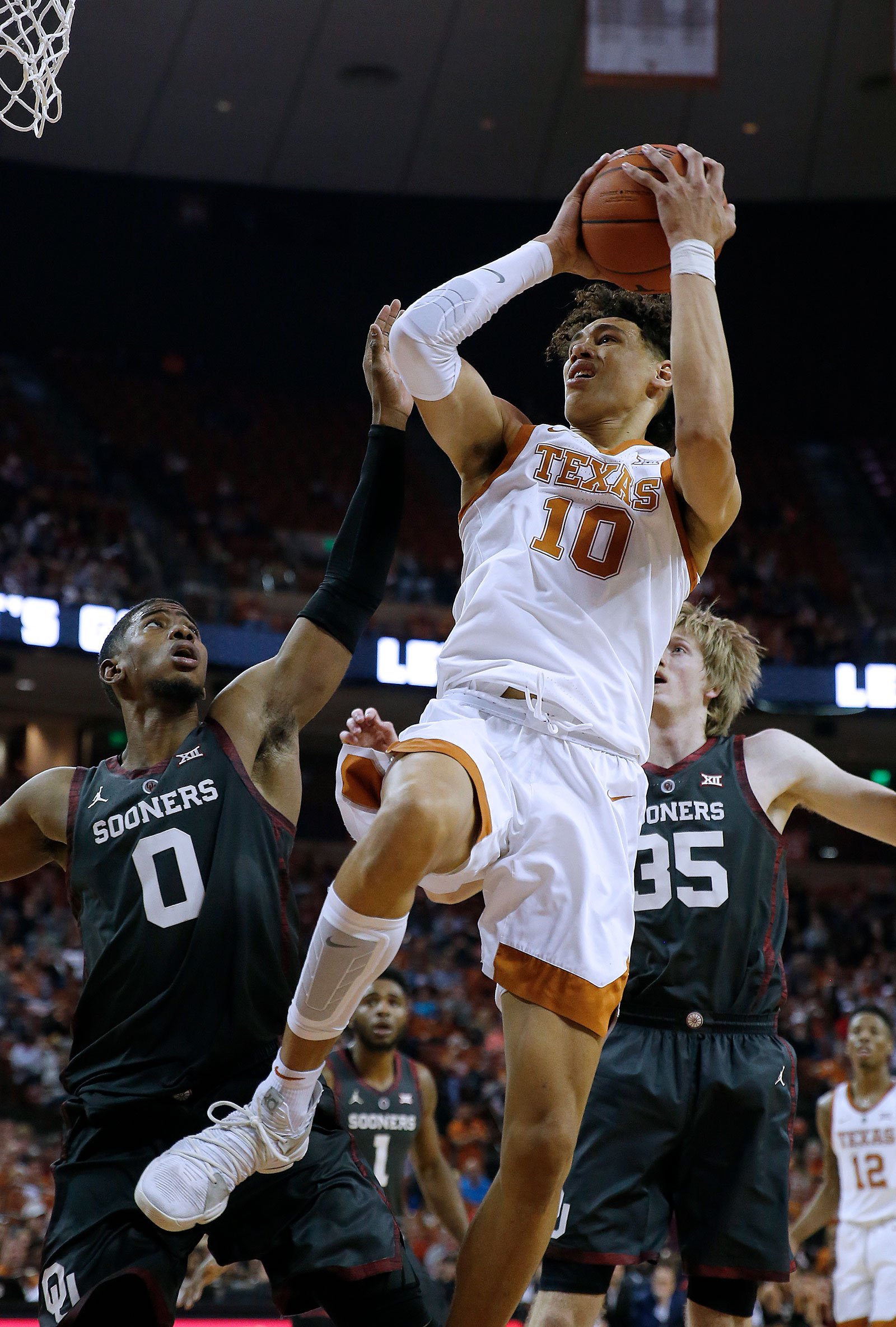 Jaxson Hayes #10 of the Texas Longhorns shoots over Christian James #0 and Brady Manek #35 of the Oklahoma Sooners during second half action at The Frank Erwin Center on January 19, 2019 in Austin, Texas.