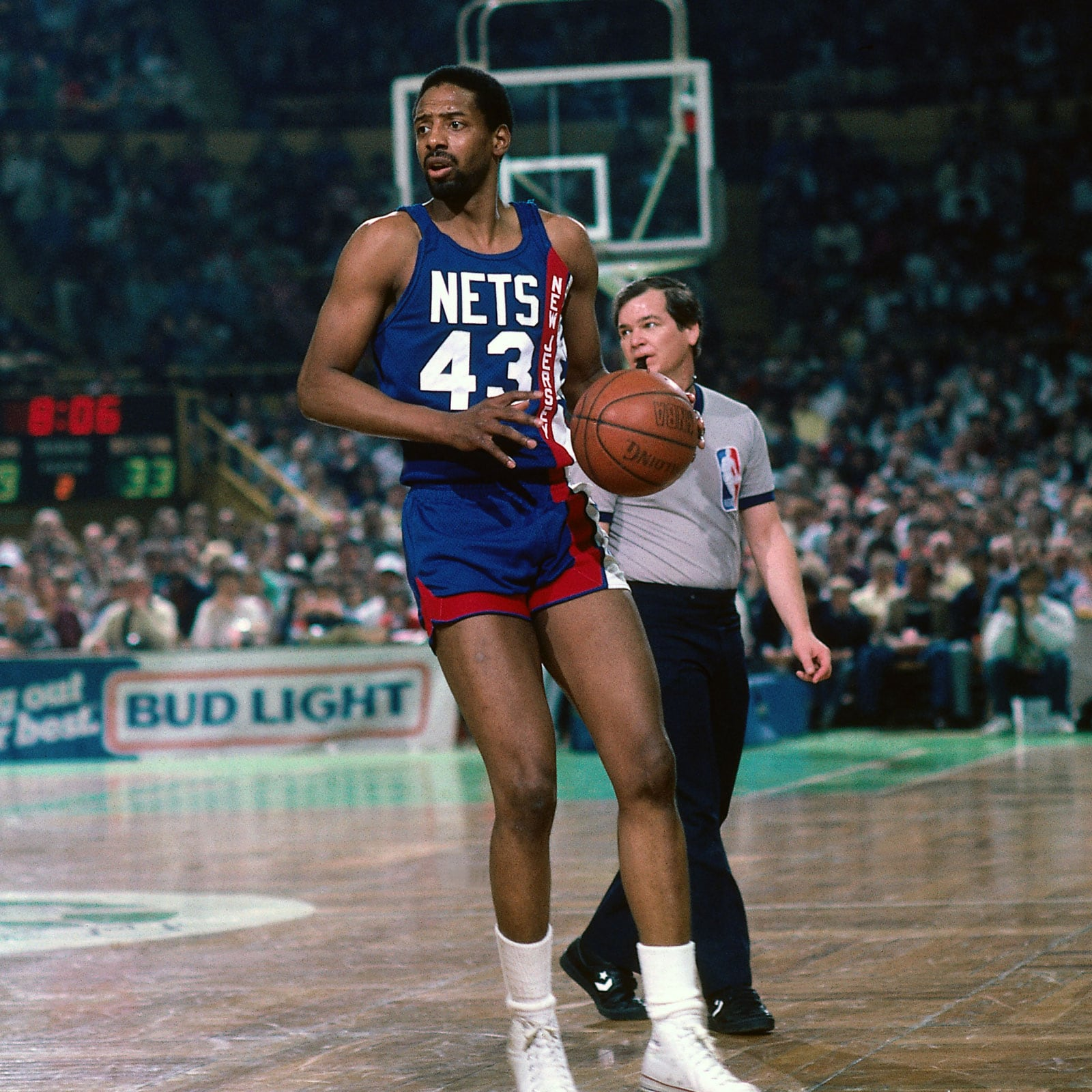 Mickey Johnson #43 of the New Jersey Nets dribbles the ball during a game circa 1986 at the Boston Garden in Boston, Massachusetts.