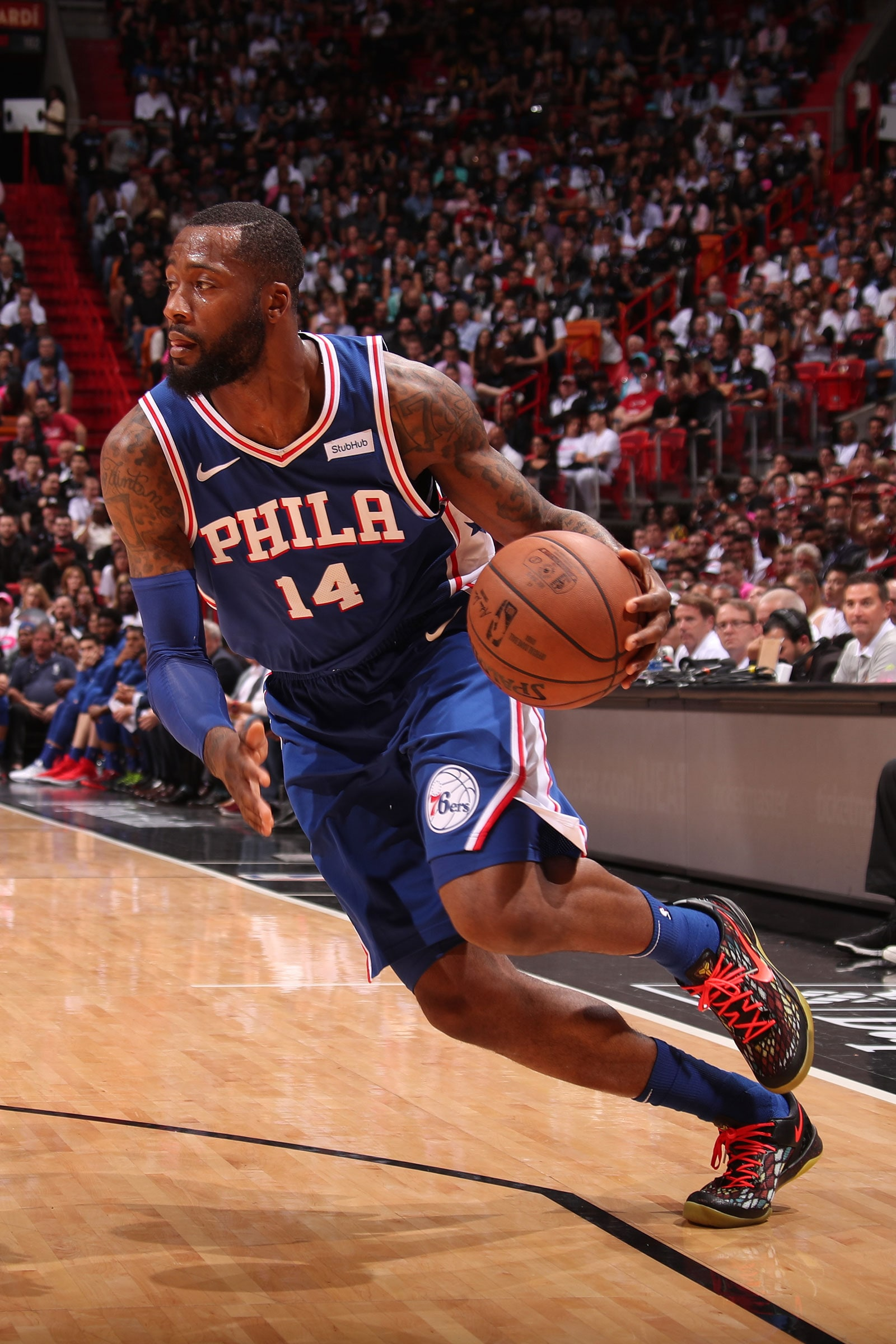 Jonathon Simmons #14 of the Philadelphia 76ers handles the ball during the game against the Miami Heat on April 9, 2019 at American Airlines Arena in Miami, Florida.