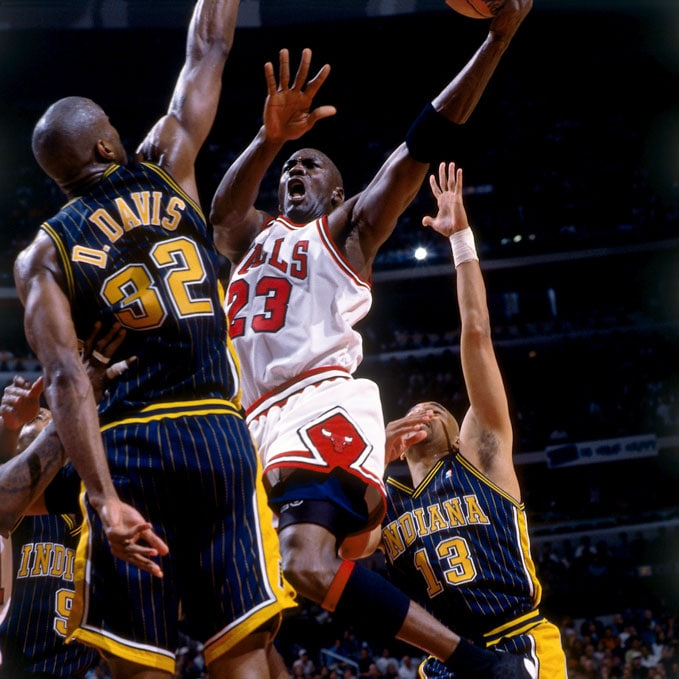 Michael Jordan #23 of the Chicago Bulls shoots the ball against the Indiana Pacers during a game in 1998 at the United Center in Chicago, Illinois.