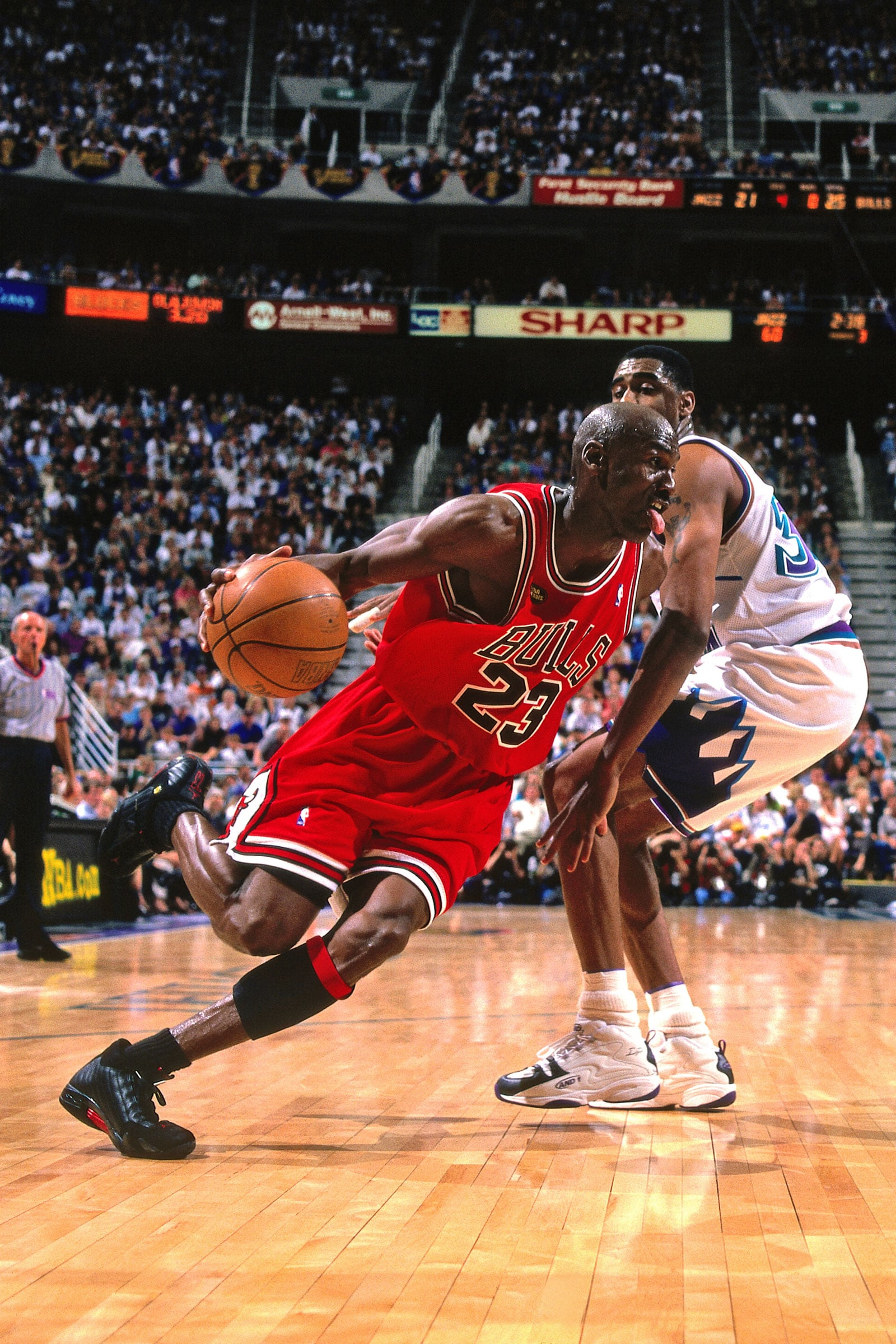 Michael Jordan #23 of the Chicago Bulls handles the ball against the Utah Jazz during Game Six of the NBA Finals during the 1998 NBA Playoffs on June 14, 1998 at the Delta Center in Salt Lake City, Utah.
