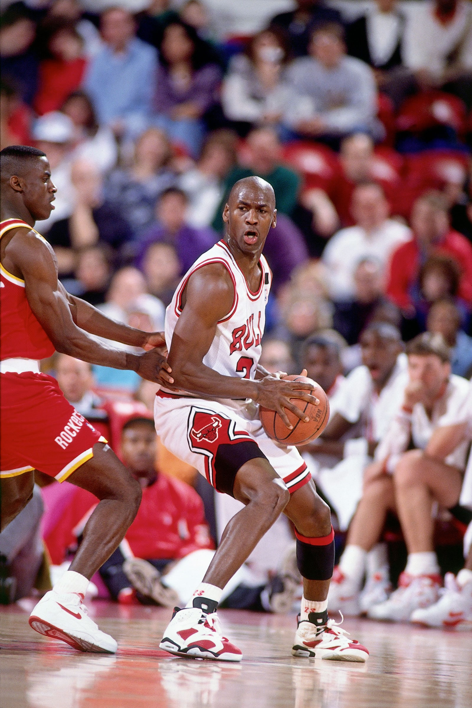 Michael Jordan #23 of the Chicago Bulls posts up against Vernon Maxwell #10 of the Houston Rockets during a game circa 1992 played at Chicago Stadium in Chicago, Illinois.