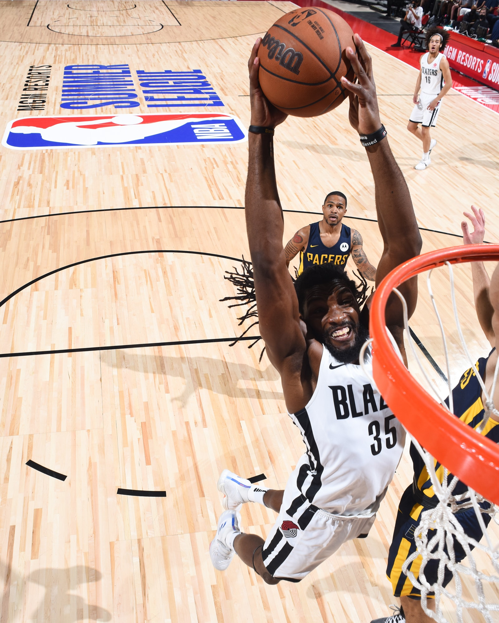 Ken Faried goes up for a dunk