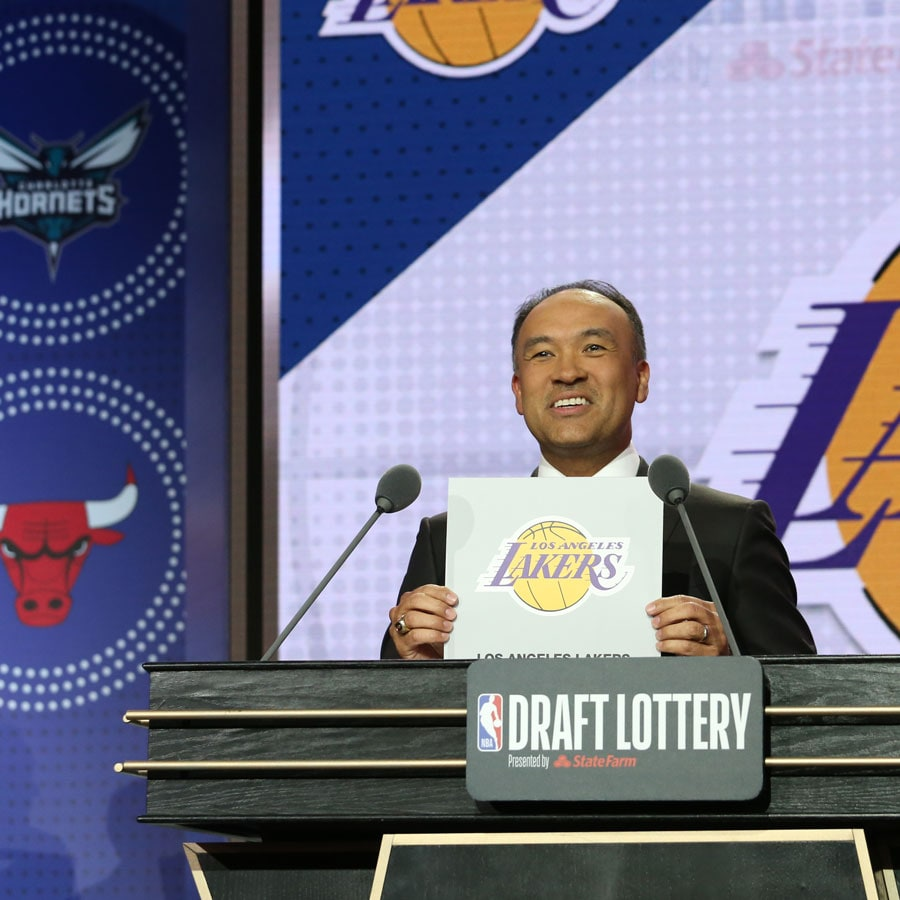 Deputy Commissioner of the NBA, Mark Tatum, holds up the card for the Los Angeles Lakers after they get the 4th overall pick in the NBA Draft during the 2019 NBA Draft Lottery on May 14, 2019 at the Chicago Hilton in Chicago, Illinois.
