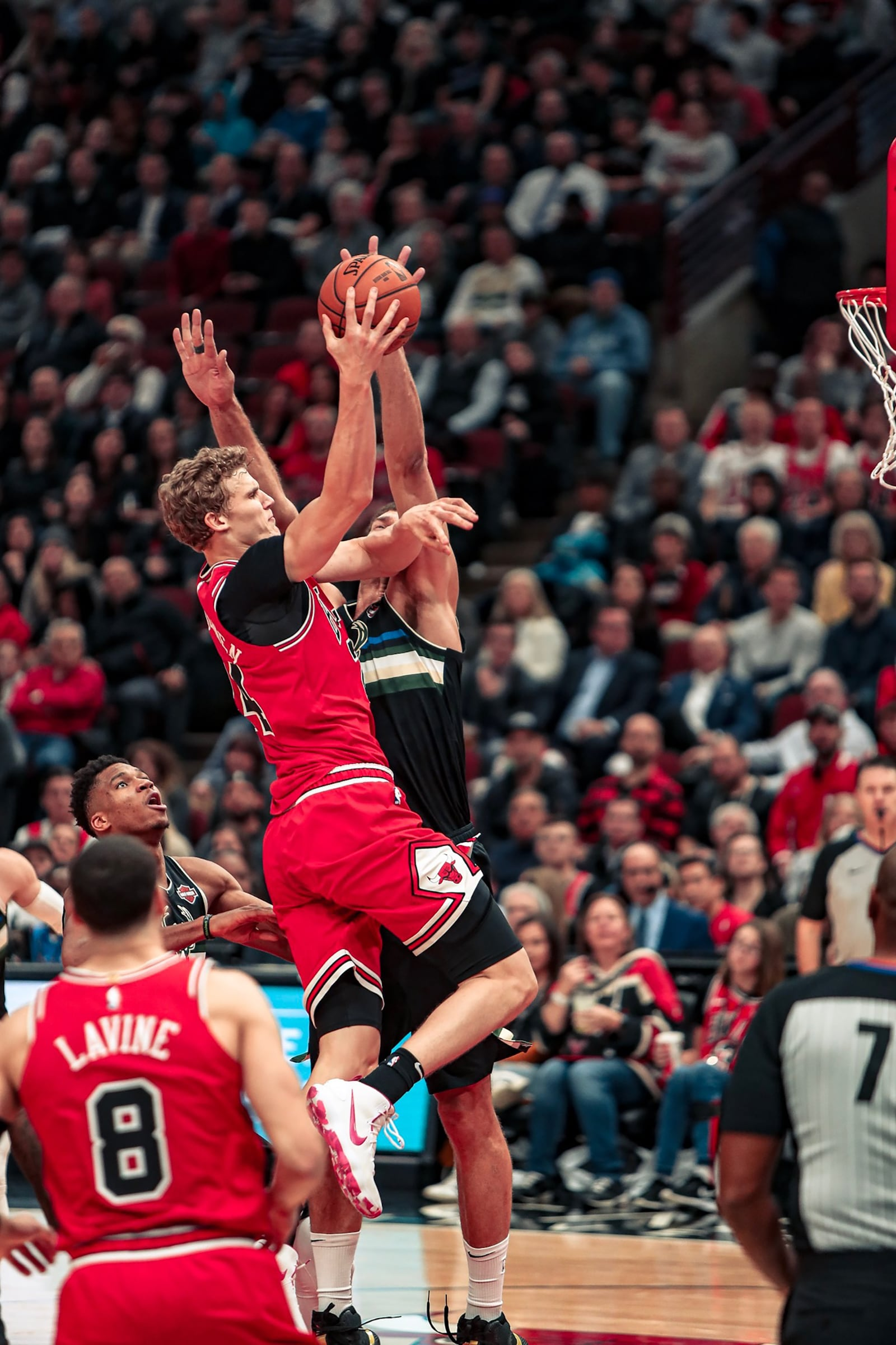 Lauri going up for a dunk against Brook Lopez