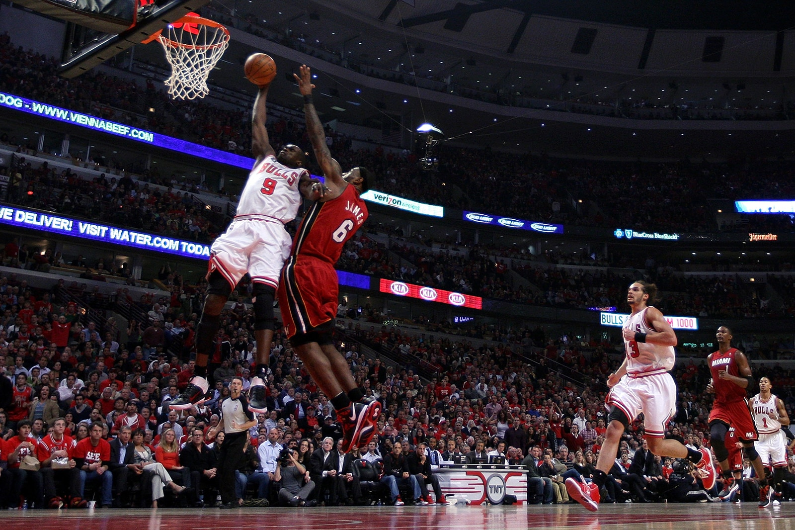 Luol Deng dunks with LeBron defending him