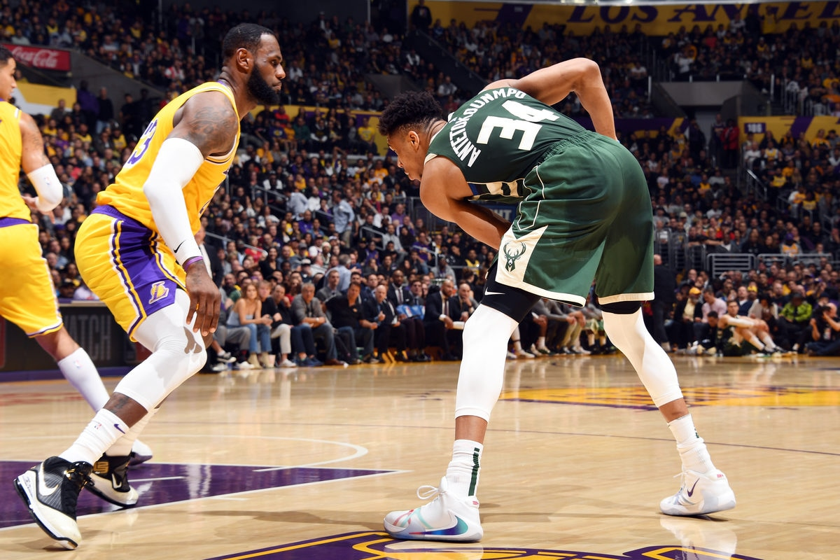 Giannis Antetokounmpo #34 of the Milwaukee Bucks handles the ball while LeBron James #23 of the Los Angeles Lakers plays defense on March 6, 2020 at STAPLES Center in Los Angeles, California.