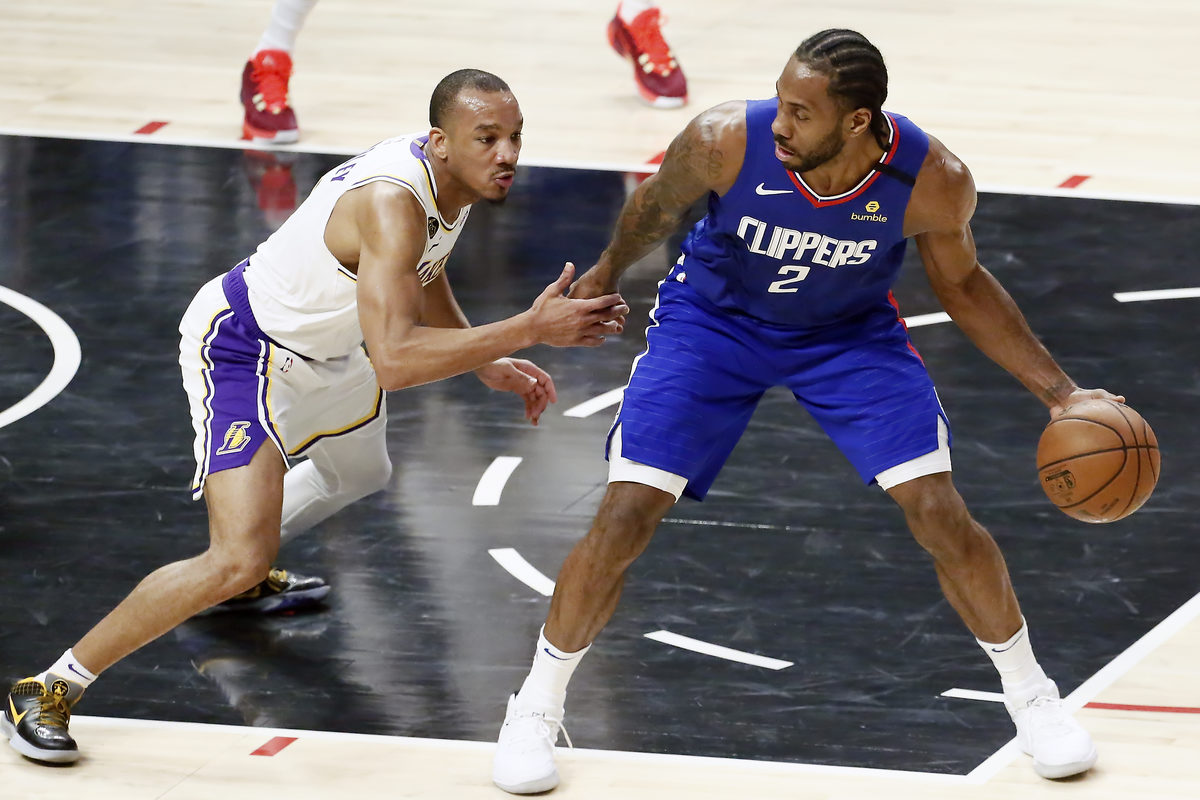 Avery Bradley #11 of the Los Angeles Lakers defends on Kawhi Leonard #2 of the LA Clippers during a game at the Staples Center on March 8, 2020 in Los Angeles, CA.