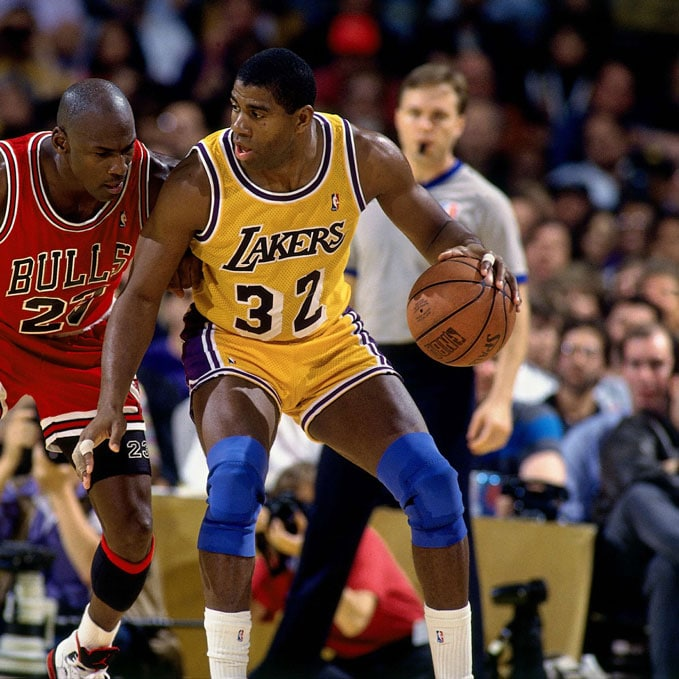 Magic Johnson #32 of the Los Angeles Lakers posts up against Michael Jordan #23 of the Chicago Bulls during the 1990 NBA Finals played at the Great Western Forum in Inglewood, California.