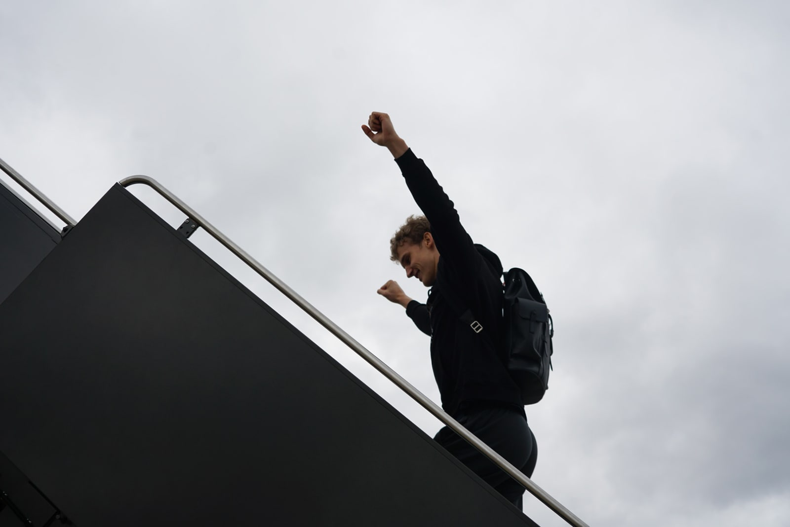 Lauri boarding the plan bound for Charlotte