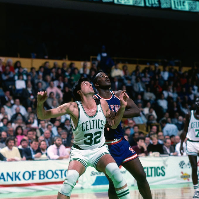 Kevin McHale #32 of the Boston Celtics boxes out against the New York Knicks circa 1990 at the Boston Garden in Boston, Massachusetts.