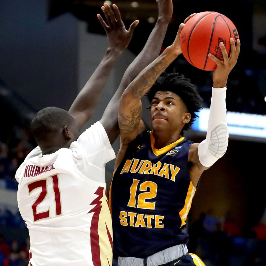 Ja Morant #12 of the Murray State Racers attempts a shot against Christ Koumadje #21 of the Florida State Seminoles in the second half during the second round of the 2019 NCAA Men's Basketball Tournament at XL Center on March 23, 2019 in Hartford, Connecticut.