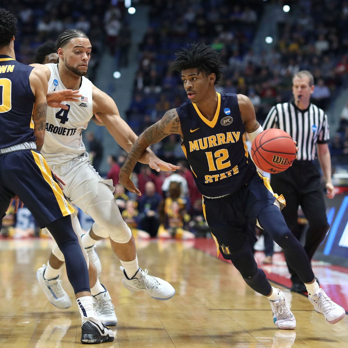 Ja Morant #12 of the Murray State Racers drives past Theo John #4 of the Marquette Golden Eagles during their first round game of the 2019 NCAA Men's Basketball Tournament at XL Center on March 21, 2019 in Hartford, Connecticut.