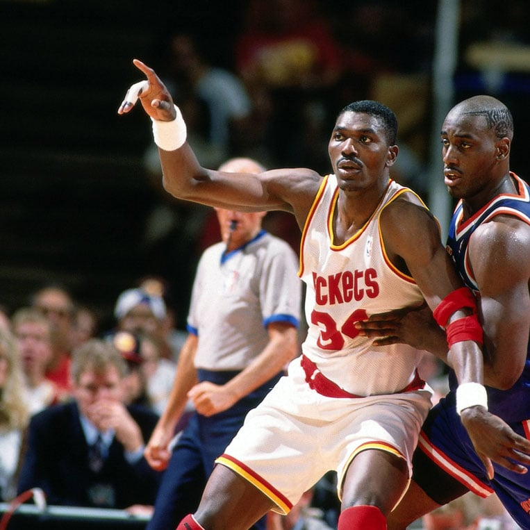 Hakeem Olajuwon #34 of the Houston Rockets posts up against Anthony Mason #14 of the New York Knicks during Game One of the NBA Finals played on June 8, 1994 at The Summit in Houston, Texas.