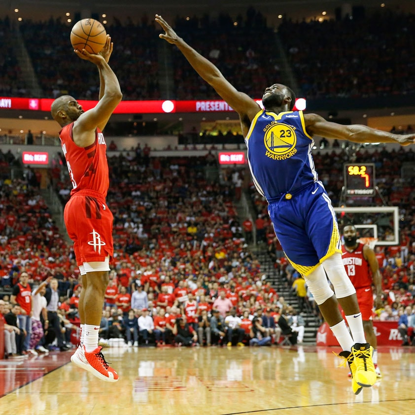 Chris Paul #3 of the Houston Rockets takes a three point shot defended by Draymond Green #23 of the Golden State Warriors in the first half during Game Three of the Second Round of the 2019 NBA Western Conference Playoffs at Toyota Center on May 4, 2019 in Houston, Texas.