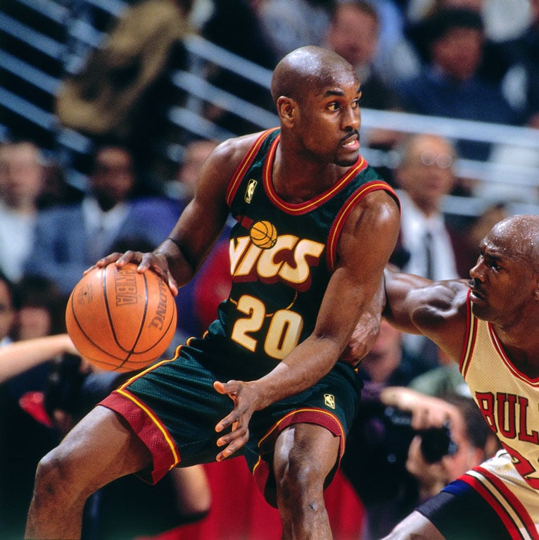 Gary Payton #20 of the Seattle SuperSonics dribbles during a game played on March 18, 1997 at the United Center in Chicago, Illinois.