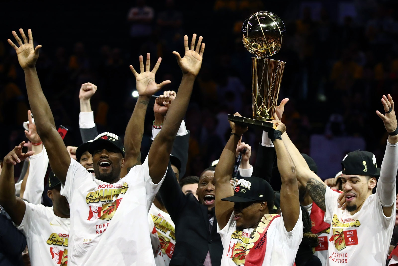 The Toronto Raptors celebrate with the Larry O'Brien Championship Trophy after their team defeated the Golden State Warriors to win Game Six of the 2019 NBA Finals at ORACLE Arena on June 13, 2019 in Oakland, California.