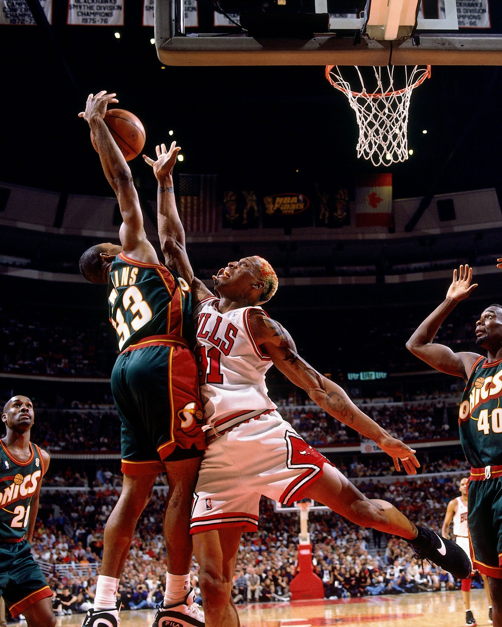 Dennis Rodman #91 of the Chicago Bulls battles for a rebound against Hersey Hawkins #33 of the Seattle SuperSonics during Game Six of the 1996 NBA Finals at the United Center on June 16, 1996 in Chicago Iillinois. The Bulls won 87-75.