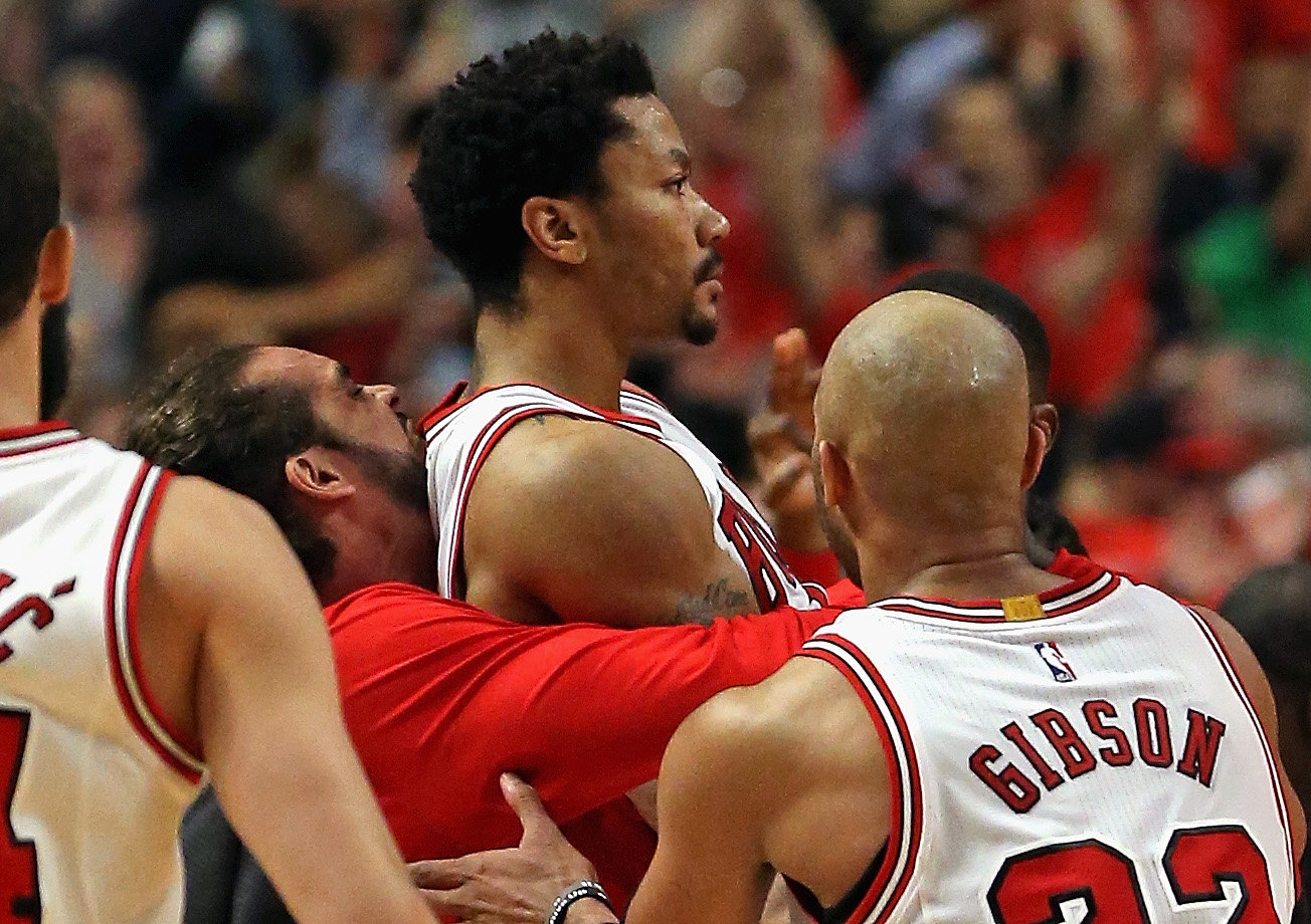 Joakim Noah #13, Derrick Rose #1 and Taj Gibson #22 of the Chicago Bulls celebrate Rose's game-wiinning shot against the Cleveland Cavaliers in Game Three of the Eastern Conference Semifinals of the 2015 NBA Playoffs at the United Center on May 8, 2015 in Chicago, Illinois. The Bulls defeated the Cavaliers 99-96