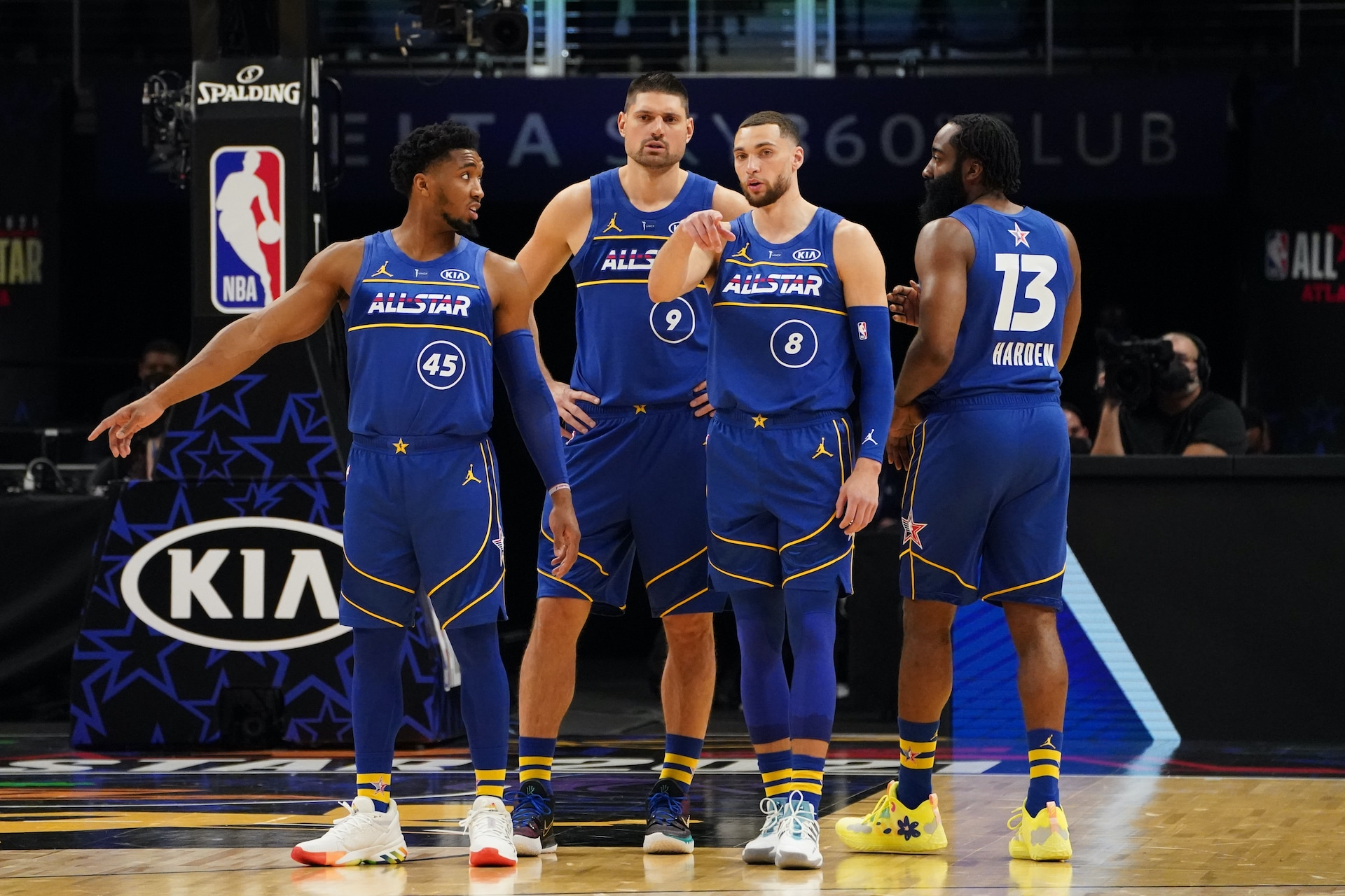 Zach LaVine points while talking to Vucevic and Mitchell at the NBA All-Star game